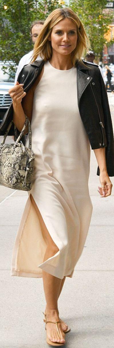 Who made Heidi Klum's white dress and black leather jacket?