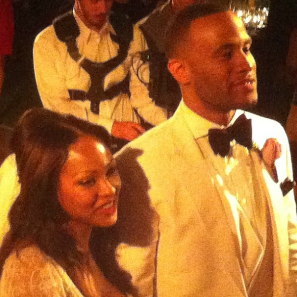 Meagan Good & Devon Franklin standing at the alter