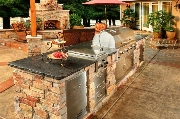 Traditional Patio with Sunstone grills flush double access doors, Outdoor kitchen, Fence, exterior stone floors