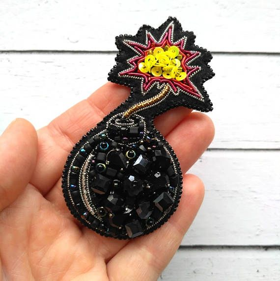 Extraordinary brooch Sex Bomd, handmade embroidered brooch with black eco-leather backing.  Brooch measures approximately 3.35 х 1.7 (8.5x4.3 cm).  This item is handmade by me one of a kind and ready to ship. Would you like to see more photos or do you need a different length? Please feel free to contact me with any questions or customization.  Looking for a more custom piece? Send me a message. Im always happy to work with my customers to customize a piece just for you!  Follow me on…