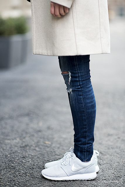 Wearing grey and silver Roshe Runs