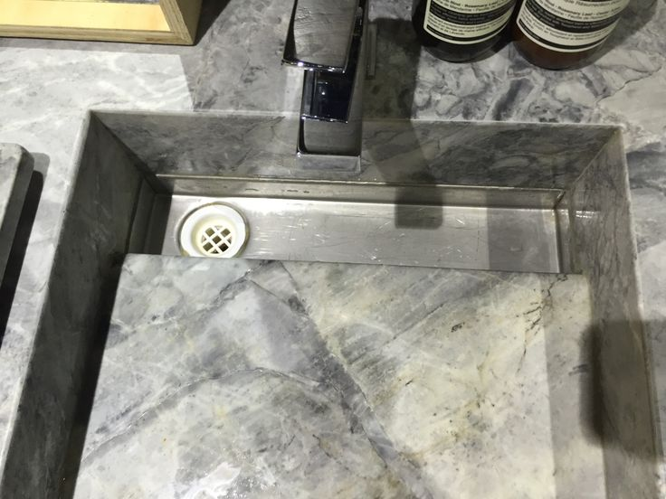 White Fantasy Quartzite vanity and sink with revealed drain. ace Fortitude Valley office. www.acestone.com.au