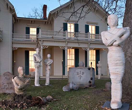 diy mummy statues scare the pants off passersby with a front yard featuring zombielike mummies that eerily rise to haunt the twilight landscape