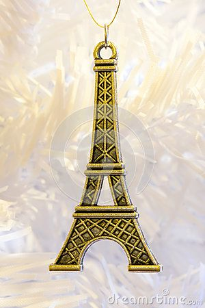 A close up of a golden Eiffel tower pendant jewellery.
