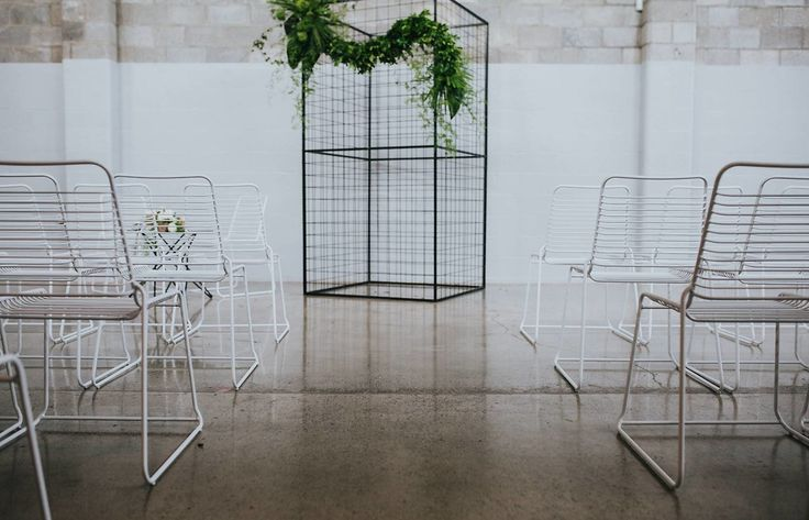 A touch of greenery gives life to the minimalist ceremony styling