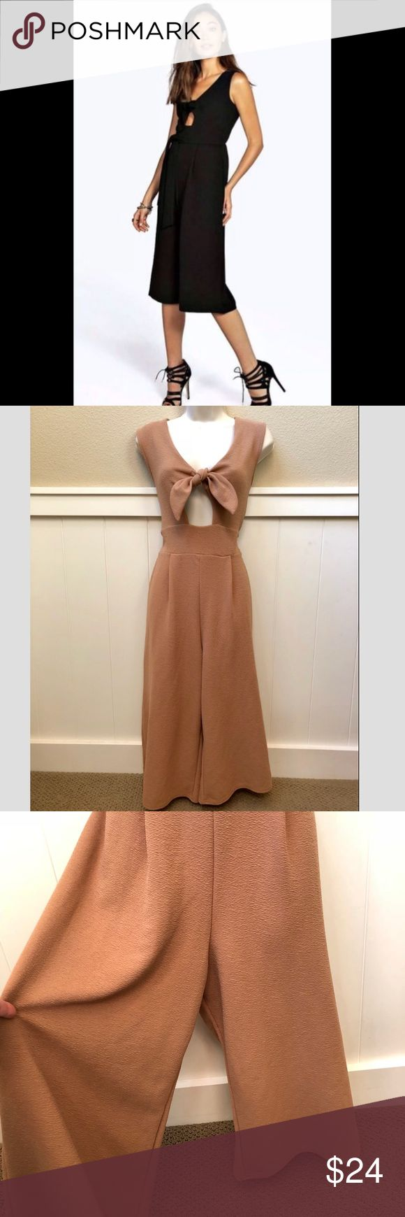 NWT Boohoo wide leg crop jumpsuit in camel color! NWT Boohoo wide leg crop jumpsuit in camel color! Comfortable and stylish with a tie back for the perfect fit. Sz 8 Boohoo Other