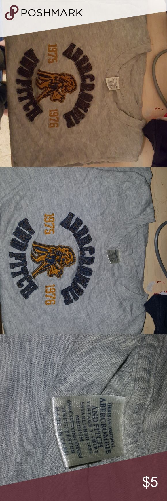 T-shirt Abercrombie and Fitch Dark blue and orange lettering on a grey shirt no holes or tears only wore once didn't like the way it looked on me. In great condition like new Abercrombie & Fitch Tops