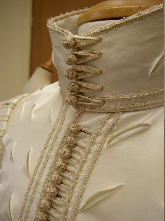 Detail of the reconstruction of a 1620s doublet Ninya Mikhaila made for Perth (Scotland) Museum. The ribbon, braid and buttons were all copied exactly and made by Gina Barrett.
