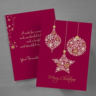 Hanging Stars Holiday Card Ornaments crafted of pretty snowflakes hang above a Merry Christmas greeting on the front of this card. The back features a red background like the front and a sprinkle of the snowflakes along with your verse and personalization.
