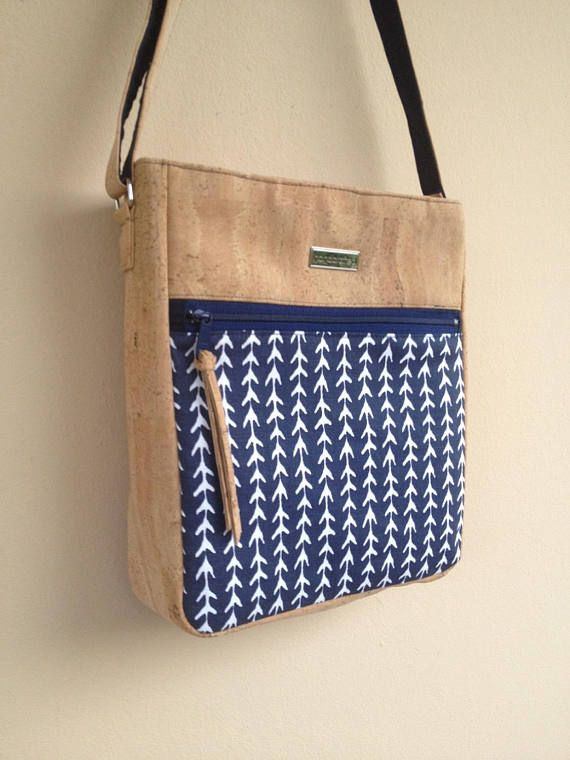 ❘❘❙❙❚❚ CLEARANCE SALE ❚❚❙❙❘❘ Handcrafted with High Quality Materials in my Home Studio. This roomy Crossbody Bag has been made with cork leather and some navy cotton canvas fabric as an accent. The canvas print has some arrows on it. On front it has a large pocket for things you want to keep at easy reach like keys or cellphone. It closes with a zipper on top. The Strap adjusts to use it on the shoulder or crossbody. Inside its been lined with a taupe cotton fabric. It has a large e-tab...