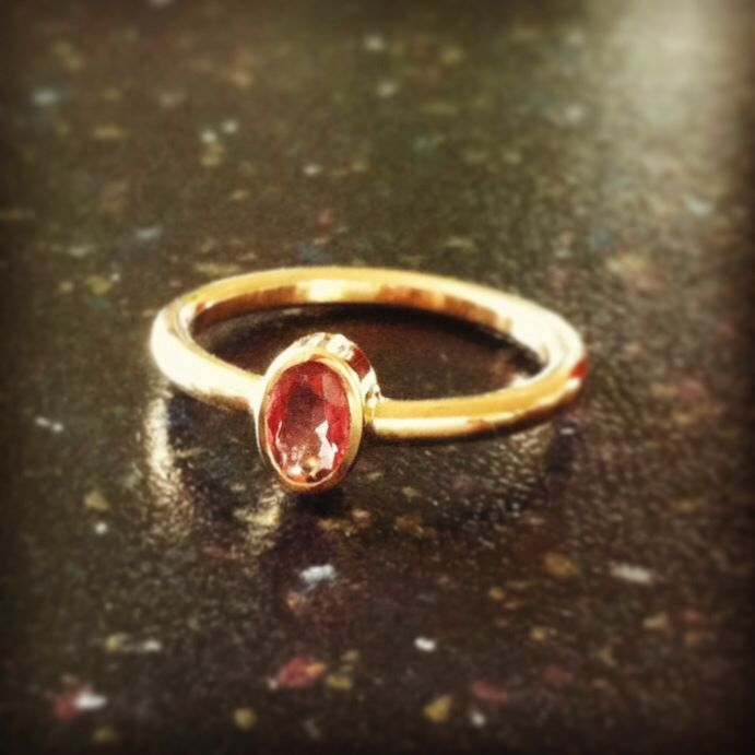 Gold ring with pink spinel