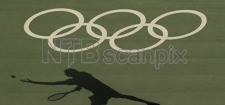 Tunisian tennis player Malek Jazira serves during a match against France's Jo-Wilfried Tsonga at the Olympic Park during the 2016 Summer Olympics in Rio de Janeiro, Brazil, Saturday, Aug. 6, 2016. (AP Photo/Charlie Riedel)