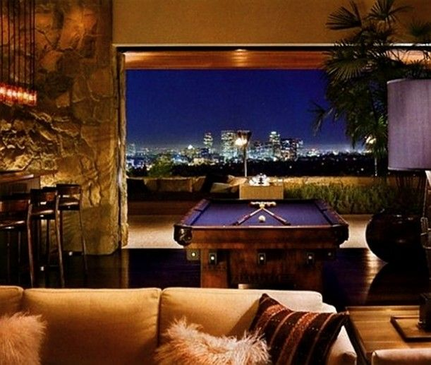 Jennifer Anistons house she just sold.  I love a girl that puts a purple pool table in her house.  Lets not mention the view.