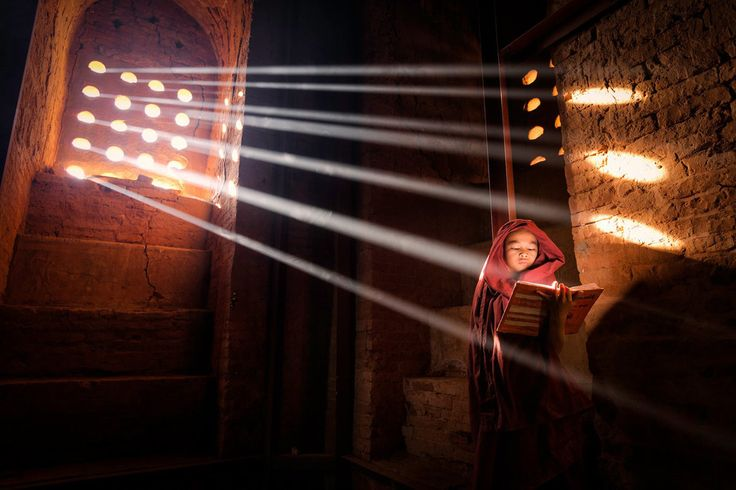 Light Source by Marcelo Castro - A young monk finds a perfect light source to read his book inside of his pagoda in Old Bagan, Burma