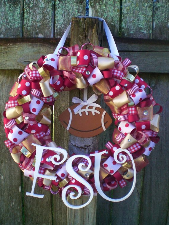 Florida State University Seminoles Ribbon Wreath with Wooden Football ... I so want one of these!!!