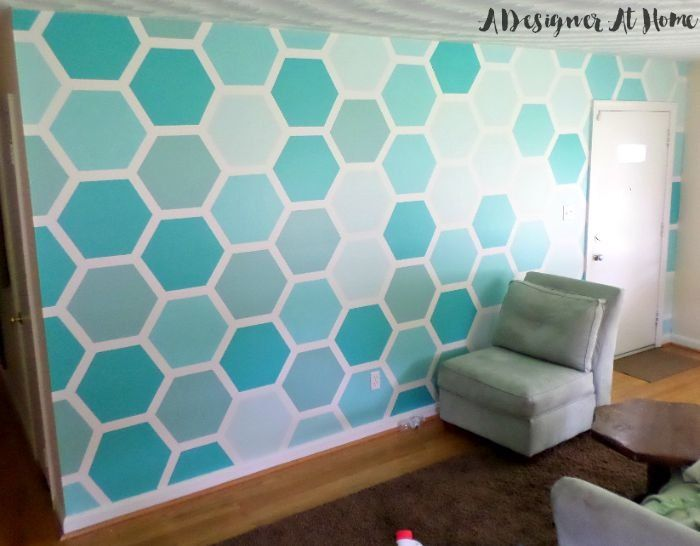 I love a graphic wall treatment, and a hexagon pattern is especially fun. I created a stencil, mixed my own paint, and created a really cool ombre painted hexag…