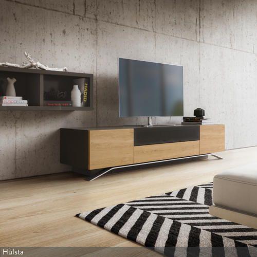 Die Minimalistische Einrichtung Des Wohnzimmers Harmoniert Mit Dem Soliden Look Der Betonwand Gleichzeitig Bilden