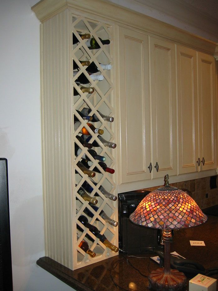 Kitchen wine rack idea, but I don't need this much storage........space for a half dozen bottles would be nice.