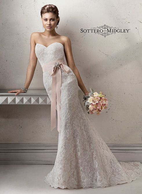 Elegant slim A-line lace wedding dress, Jennifer by Sottero and Midgley. Complete with romantic sweetheart neckline and illusion back.