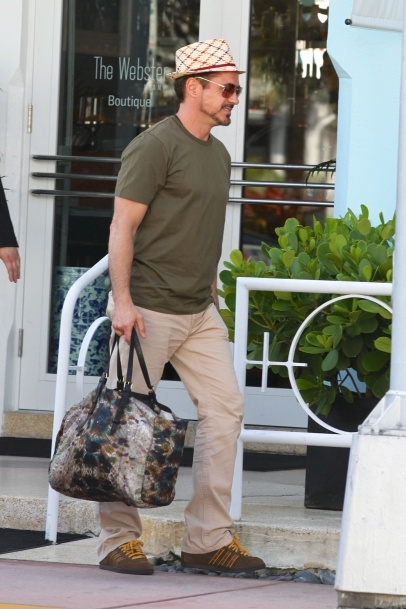 Robert Downey Jr shops with his family at 'The Webster' boutique in Miami Beach, FL. The 'Ironman' actor wore a fedora with an olive shirt and khaki trousers. 10-4-2012