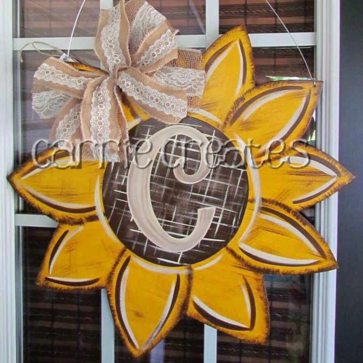 Rustic Sunflower Door Hanger  $45  To place an order, go to CARRIE CREATES on Facebook and private message me. If you do not have access to FB you can email me at Carrie.baggett@yahoo.com $45 made from wood, safe for exterior doors and can be shipped anywhere in the U.S.  More pictures on FB (sizes and descriptions listed on FB) I also have a website www.creationsbycarrieb.com