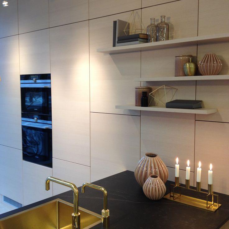 HTH Kitchen,  Showroom HTH Lyngby DK. Ash, Brass, Dark Dekton Kelya.