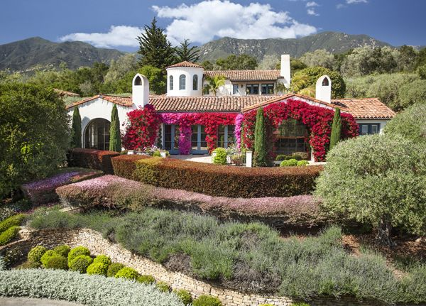 Stunning mix of bougainvillea vines adorn the outside of for Santa barbara style house