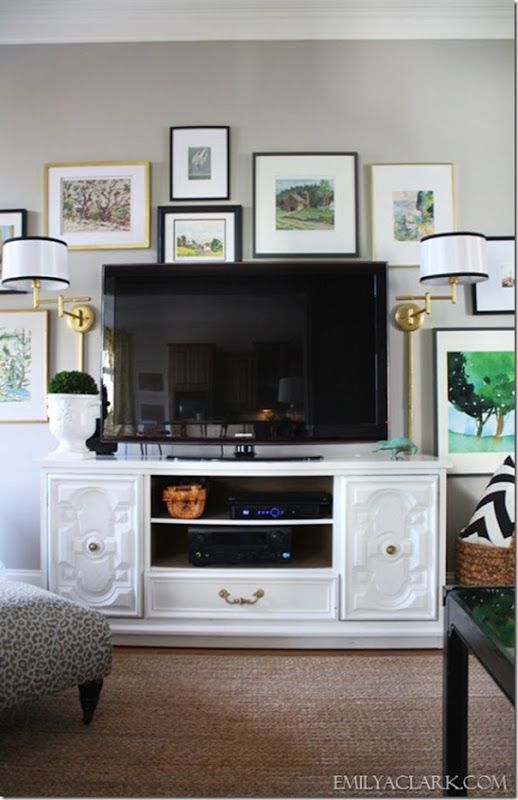 Sconces flanking tv