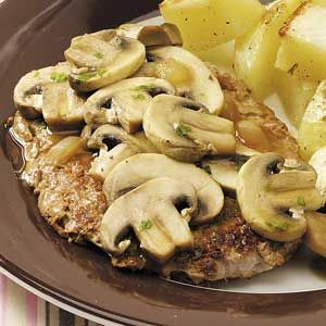 """Veal with Mushroom-Wine Sauce Recipe -A tender and flavorful main course, Veal with Mushroom-Wine Sauce, brings a touch of elegance to the dinner table. """"This delicious entree came from a cookbook filled with low-fat recipes. We altered it a bit to better suit our tastes,"""" says Julie Kocur of Abingdon, Maryland."""
