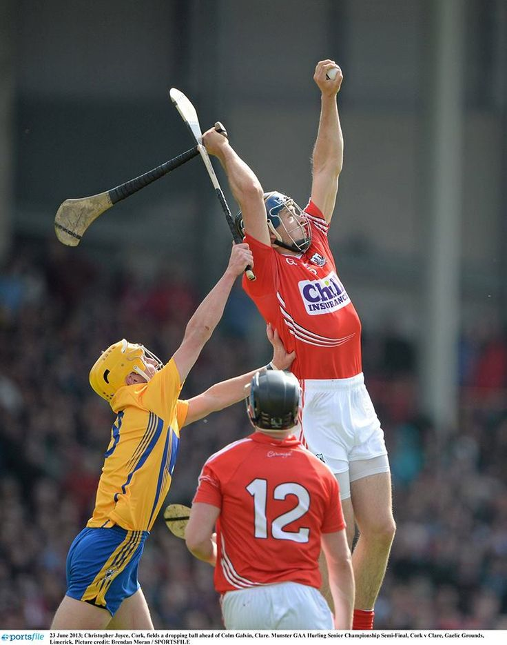 Hurling: Cork (in red) and Clare competing in the Munster Championship
