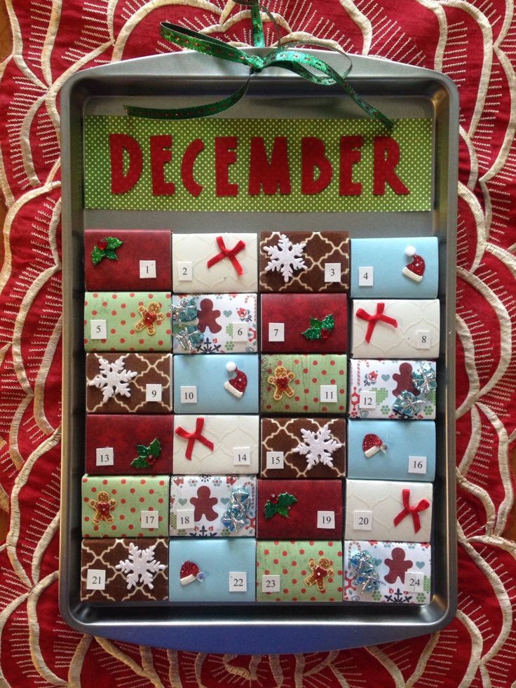 Matchbox Magnetic Cookie Sheet Advent Calendat by TwoCatsCalendars on Etsy https://www.etsy.com/listing/487792077/matchbox-magnetic-cookie-sheet-advent