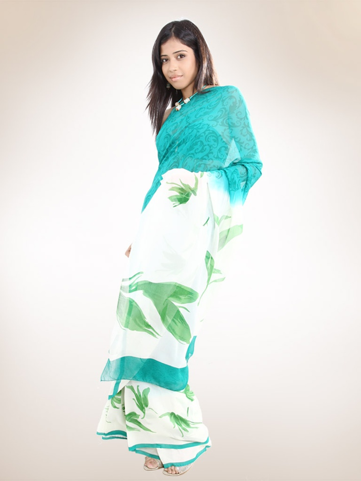 The teal colour sari body printed in a beautiful jade colour leaf   pattern has a pallu in off-white colour.The pallu and  is adorned with leaf pattern in green shades.