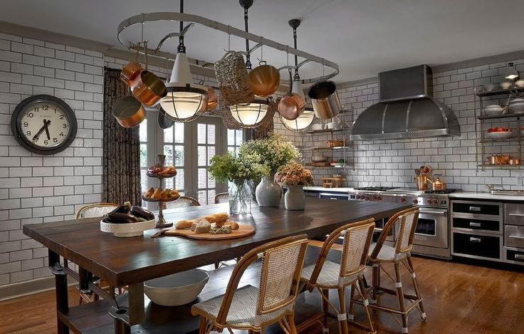 Eclectic kitchen features an oval pot rack lined with copper pots and Henry Industrial Hanging ...