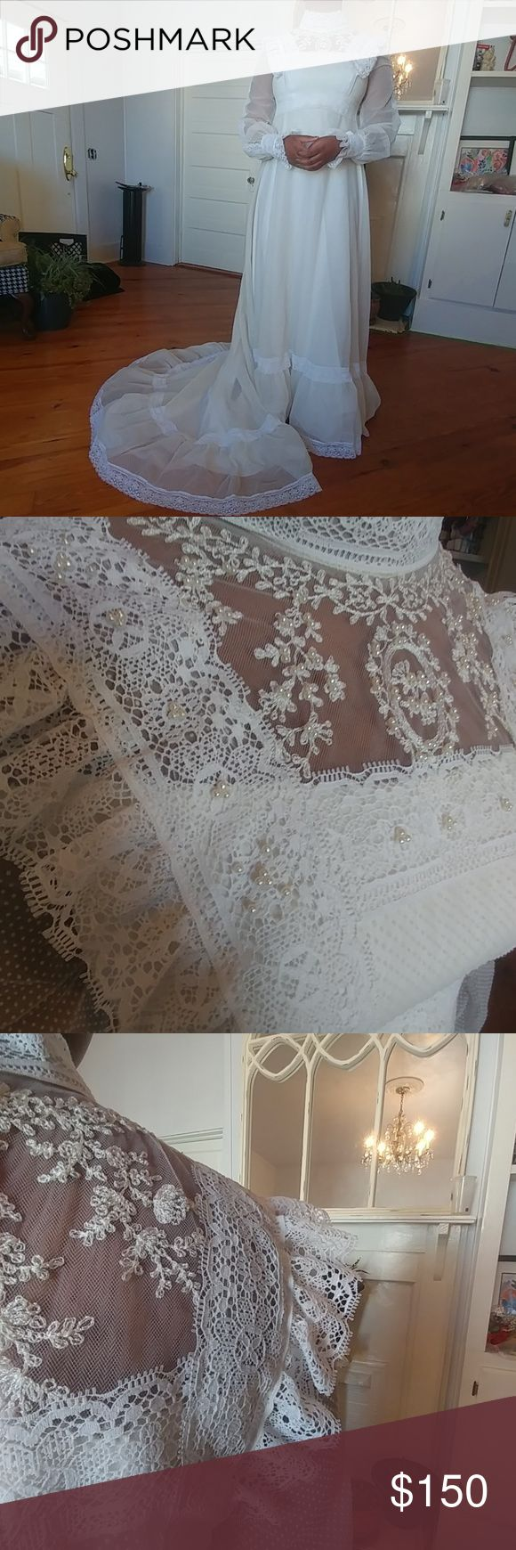 Vintage hand-sewn wedding dress & veil Seed Pearl chest. Lace. Sheer polka dot fabric. Hidden zipper back. No Label.  Size approximately extra small.  Measures approximately 17 inch from underarm to underarm.  Waistline measures approximately 14 in flat.  Hips measure approximately 22 in flat. Length measures approximately 60 inches from shoulder to front hemline line. Excellent condition! Vintage Dresses