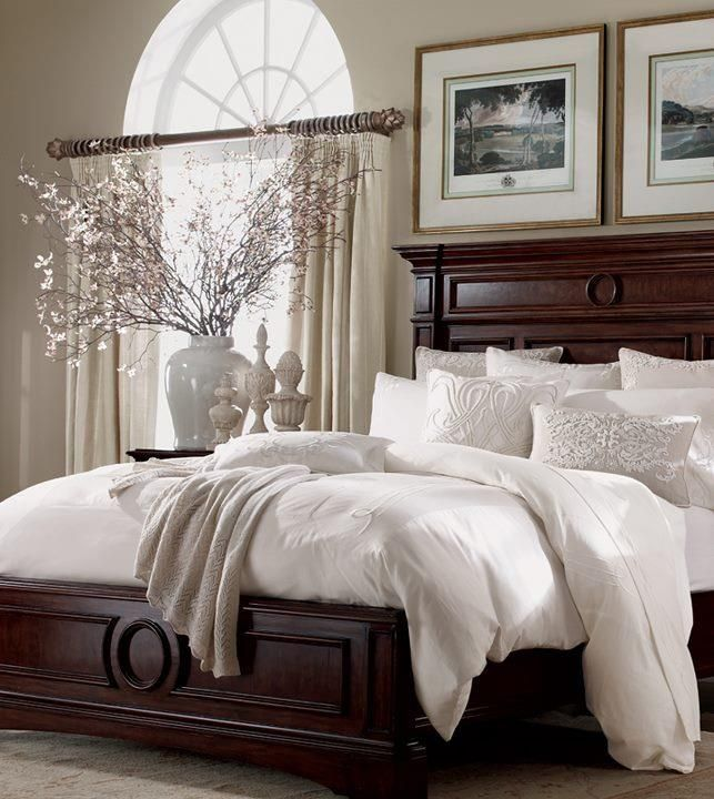Bedroom decor--I love this look. Dark wood. White bedding. Gorgeous pillows. Sophisticated accessories. Heaven.