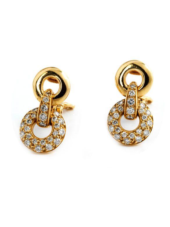 Länge: ca. 2 cm. Gewicht: ca. 9,2 g. GG 750. Hübsche, zeitlose Ohrclipse aus verbundenen Ringen mit Brillanten, zus. ca. 0,8 ct. Französische Punzen....
