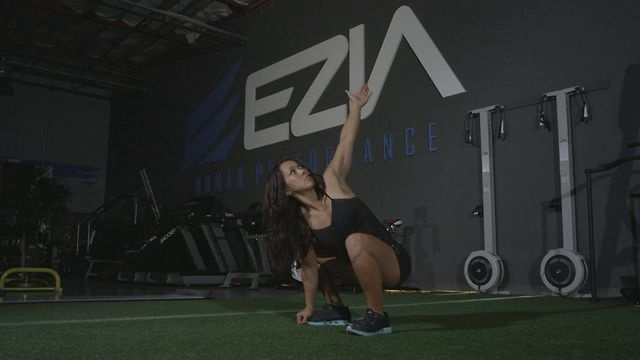 Squat Stretch by EZIA Human Performance. 1. Start - Standing in an athletic position, hinge forward at the hips until you grab your feet with your hands.