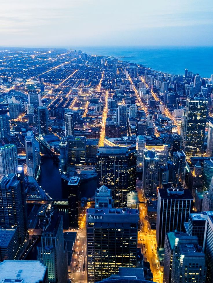 A look out over Chicago from Sears / Willis Tower just as the blue hour begins.