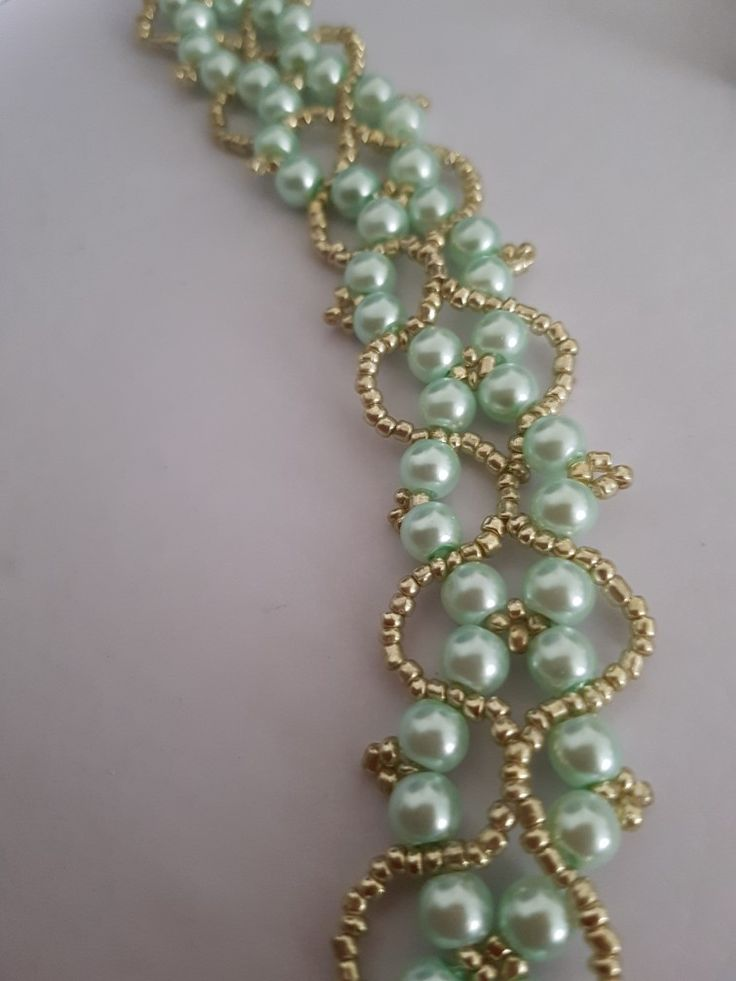 Gold and almond green bracelet