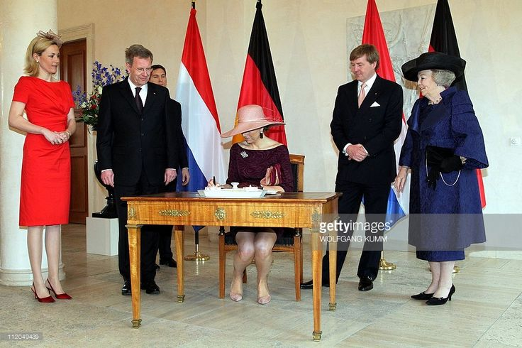 Dutch Crown Princess Maxima (C) signs the guest book of German President Christian Wulff (2nd L) as Queen Beatrix of the Netherlands (R), Dutch Crown Prince Willem-Alexander (2nd R) and Bettina Wulff (L) look on at Bellevue Palace in Berlin on April 12, 2011. Queen Beatrix is on a four-day official visit to Germany.