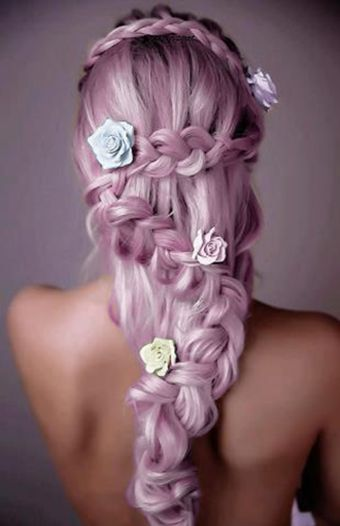 How pretty is this pastel pink, braided hair style with flower details? #plaits #wedding #hairstyles