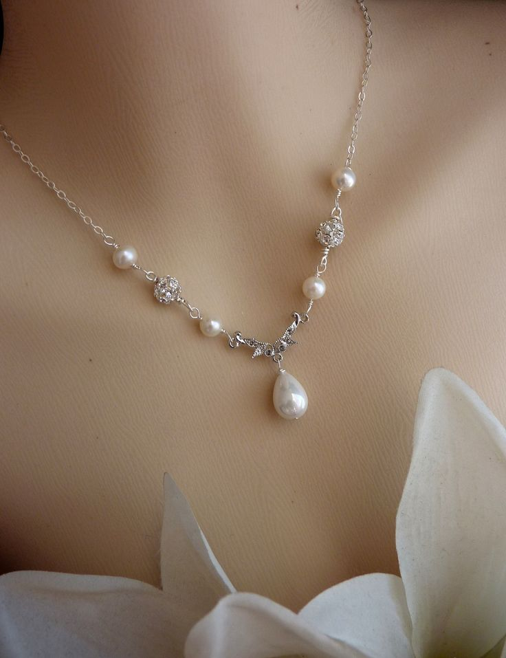 Bride Necklace - Big White Tear Drop Pearl, Diamontes Crystal Necklace in Sterling Silver Chain. $42.00, via Etsy.