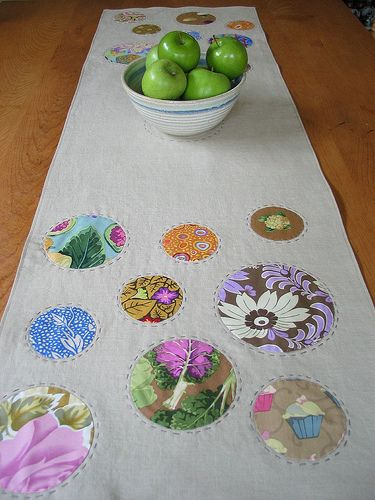 """Crop circle table runner at Poppyprint (British Columbia, Canada): """"It's a simple case of scrap, cut, sew, flip and stick! It's super versatile... you'll be appliqueing circles onto bags, onesies, quilts, t-shirts, jean jackets, curtains, pillows and who knows what else?""""  Shown with fabric scraps, but flowered shirts would work."""