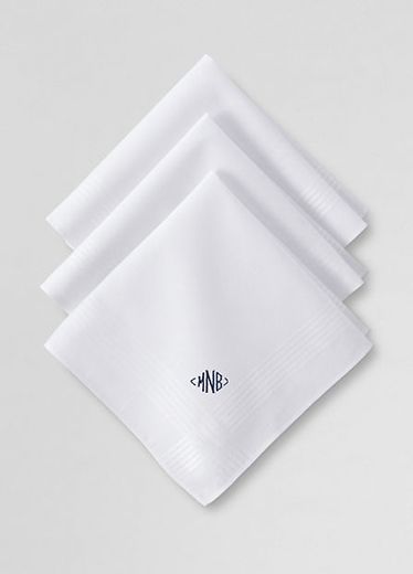 A crisp white pocket square never goes out of style, and is one of a few things that looks great with monogram.