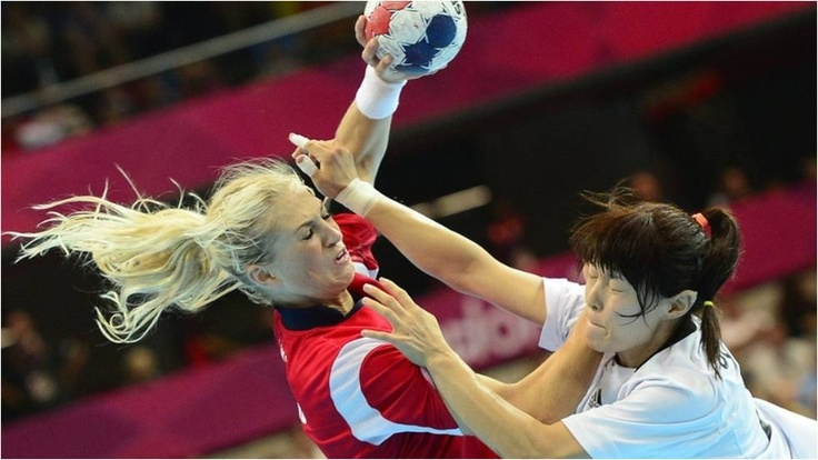 Norway's Linn Jorum Sulland vies with South Korea's centreback Jihae Jung during the women's handball match at Copper Box