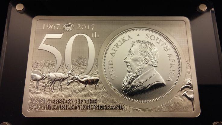 Hvězda numismatického svátku v Berlíně- Krugerrand vsazený do stříbrné cihličky