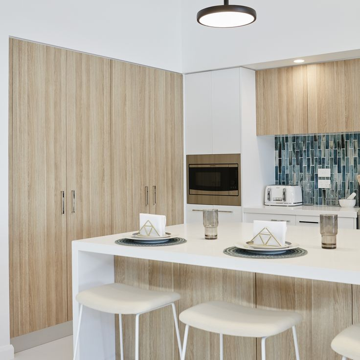 #kitchen #storage #pantry #timber #white #cupboards #splashback #greenblue #stools #breakfastbar