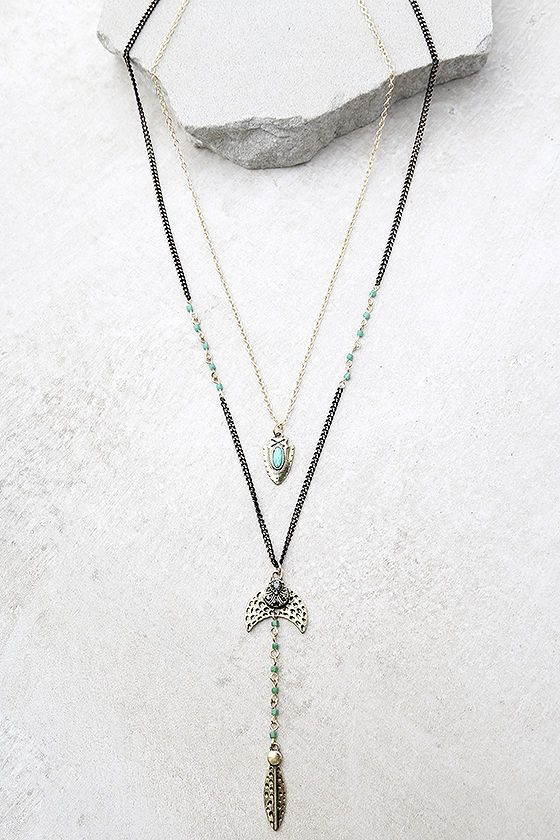 """Style the Arrow Expert Black and Gold Layered Necklace and show off your knack for discovering chic finds! Two layers of black and gold chain boast green beads, and gold charms with stone accents. Shortest chain measures 20"""" around with a 4"""" extender chain."""
