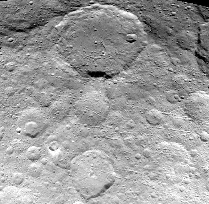 NASA's Dawn spacecraft captured this image of the dwarf planet Ceres' heavily cratered surface on May 23, 2015, from a distance of 3,200 miles (5,100 kilometers).<br />