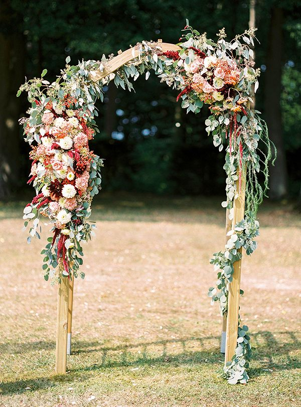 wedding arch - photo by Ashley Ludaescher http://ruffledblog.com/colorful-bohemian-german-wedding